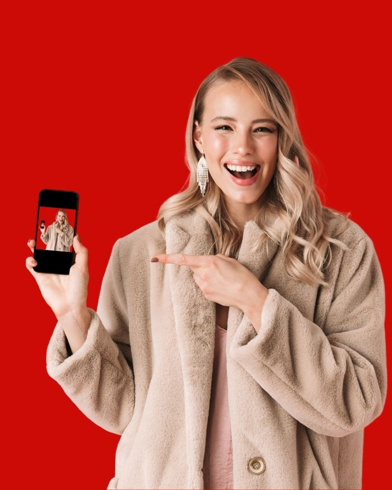 woman holding a fixed smartphone with screen repaired