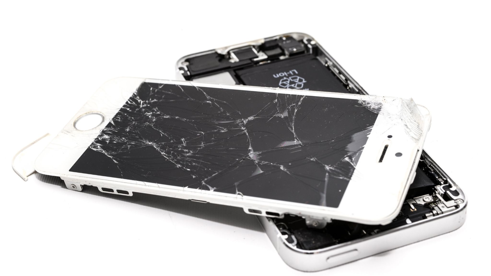 image of a white smartphone split in half with a cracked screen.